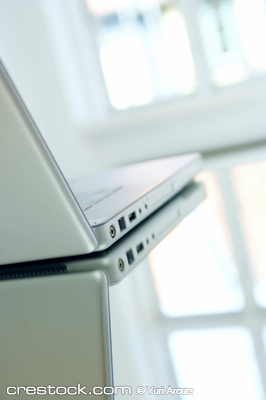 Nice laptop on a glass table. Reflections from...